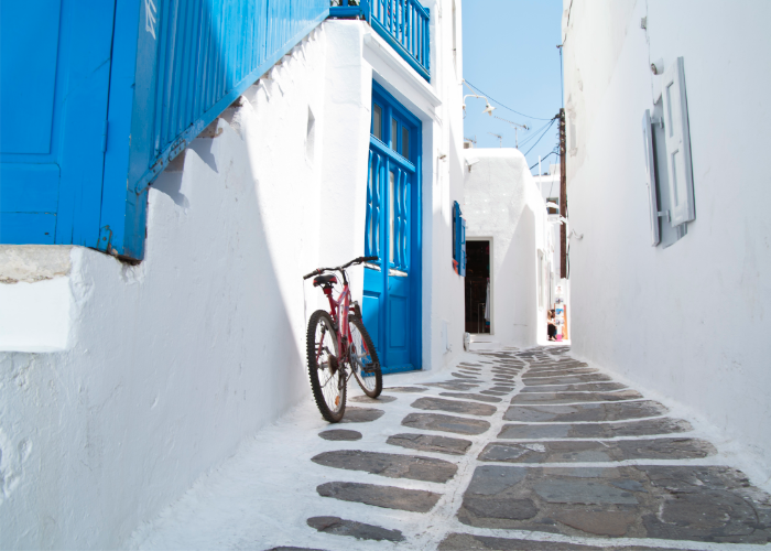 roam the white-washed alleyways found all over the Greek Islands