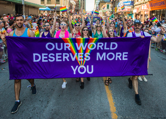 flying our banner high at a past Pride Parade