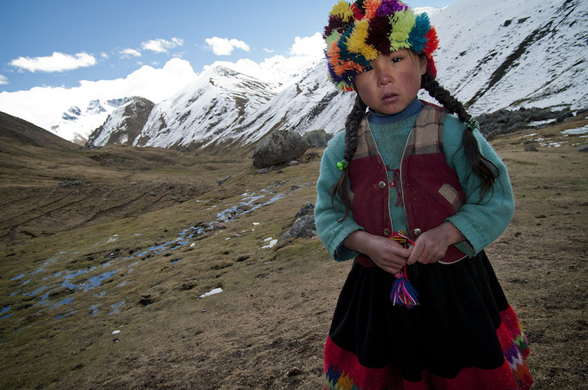 quechuan girl staring into the camera.