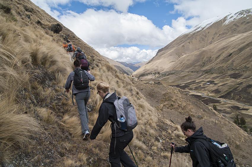 Trekkers walking up an inclide.