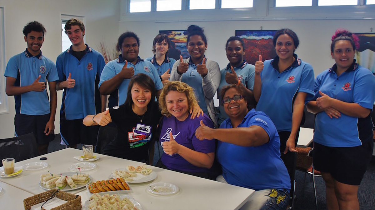 50 in 5: A group of Aboriginal youth smile during capacity training in Australia.