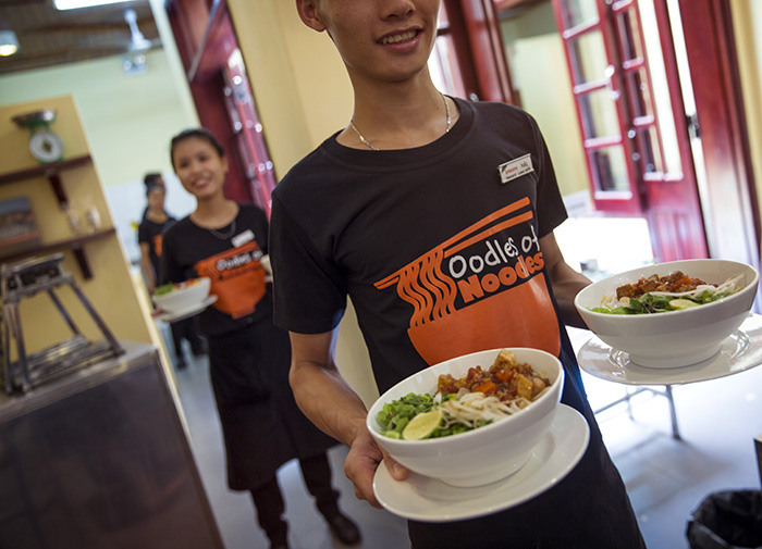 Spread oodles of support to at-risk youth serving up tasty noodles