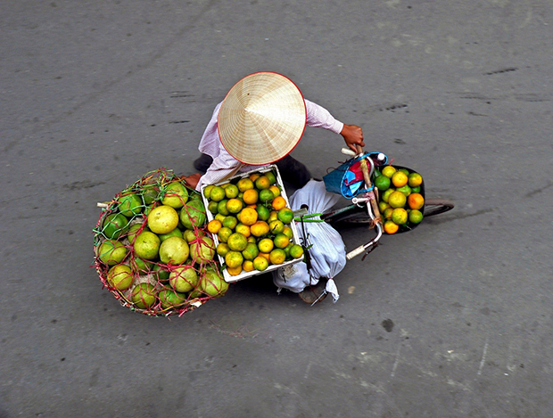 Fruit seller in Vietnam. They were passing under my hotel balcony all day long, and couldn't resist to take a pic, photo by Jimmy Sallis