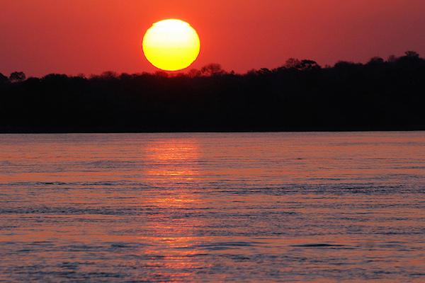 Take in the sunset from the Zambezi river. Photo courtesy Harvey B.