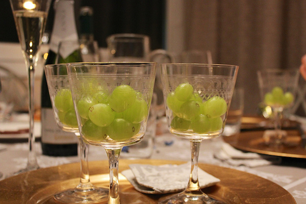 12 grapes in a fancy glass