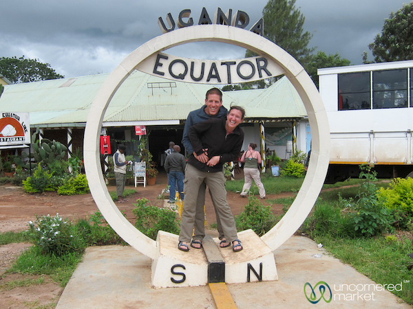 dan and audrey standing under the equator sign