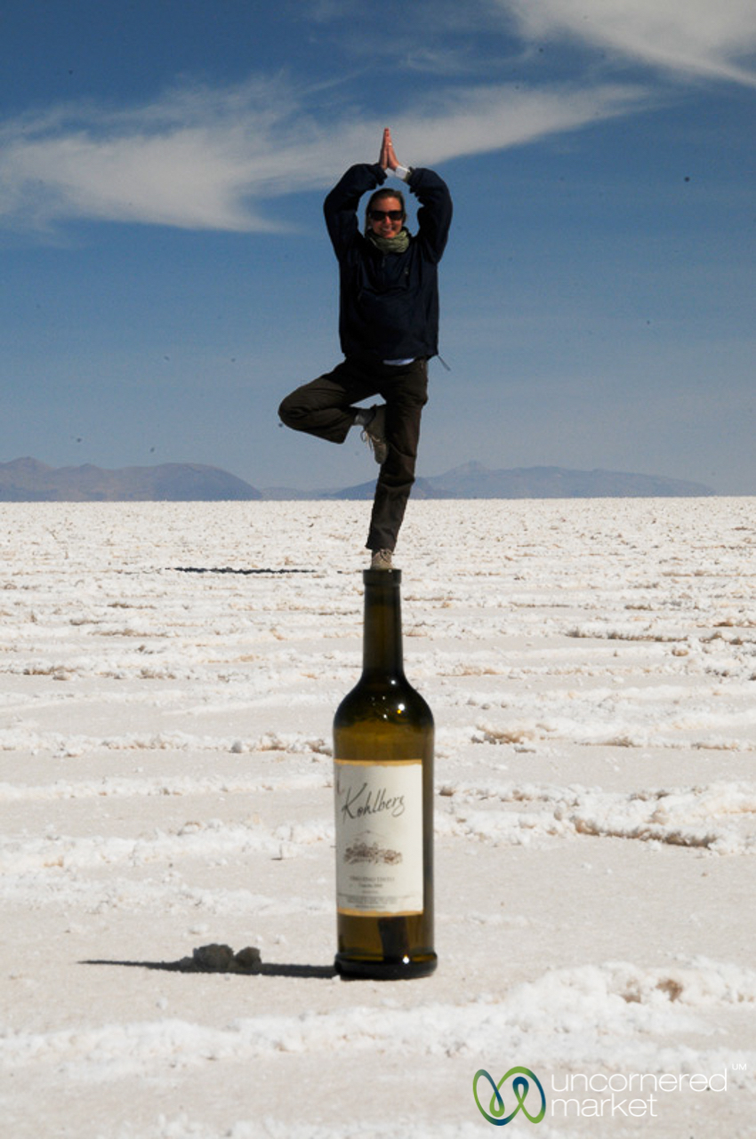 Wine yoga at dawn on the salt flats, Bolivia's Salar de Uyuni.