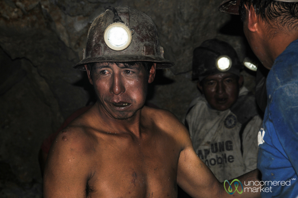 A miner halfway into his shift, cheeks filled with coca leaves.