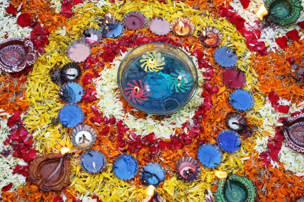 Many families draw a colorful rangoli, a decorative pattern made in rice flour, at the entrance of their homes.