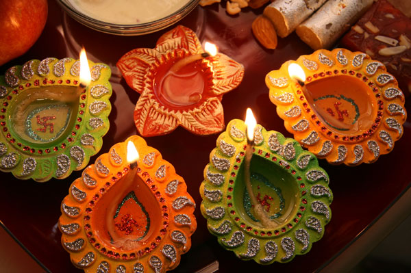 Diwali involves the lighting of small clay lamps filled with oil to signify the triumph of good over evil.
