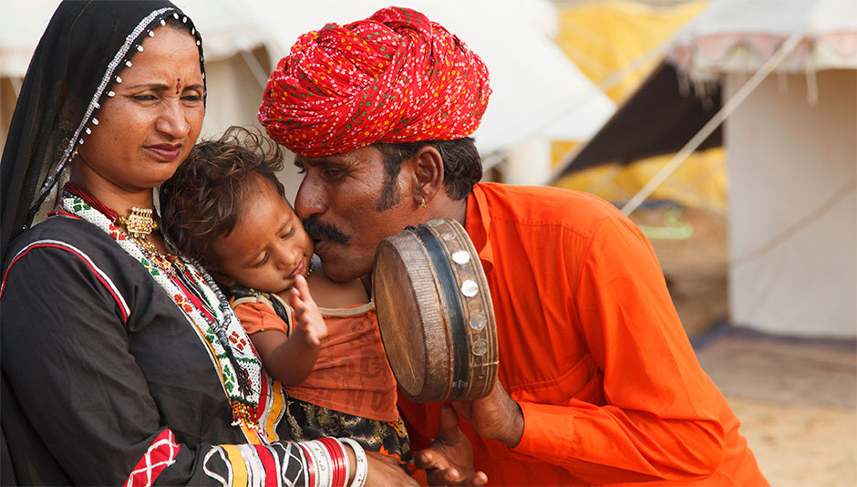 A brief history of kissing across cultures g adventures a family shares a kiss near pushkar in rajasthan india m4hsunfo