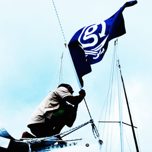 Raising the G Nation flag on the sail boat