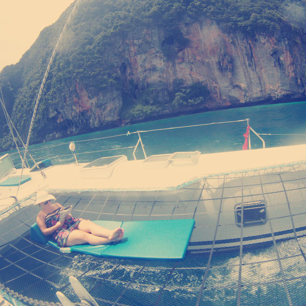 reading on the catamarin deck
