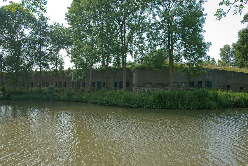 Between 1883 and 1920, the Dutch created a ring of fortifications around Amsterdam to protect it from invasion. Extending 135km or 83 mi around the city, the forts worked in conjunction with strategic flooding of polders – low-lying pieces of land that are surrounded by embankments – to protect the city. These fortifications were named a UNESCO World Heritage Site in 1996.