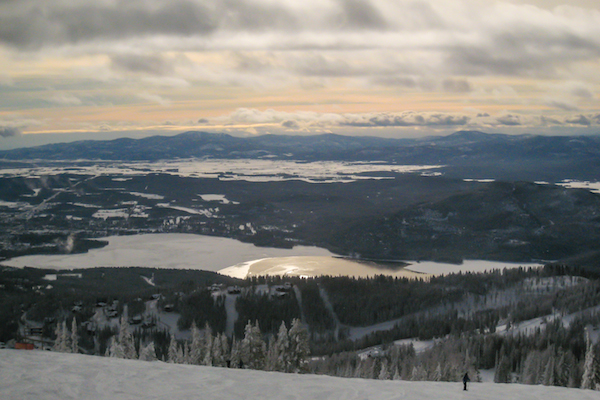 View at sunset over Glacier National Park and Flathead Lake.