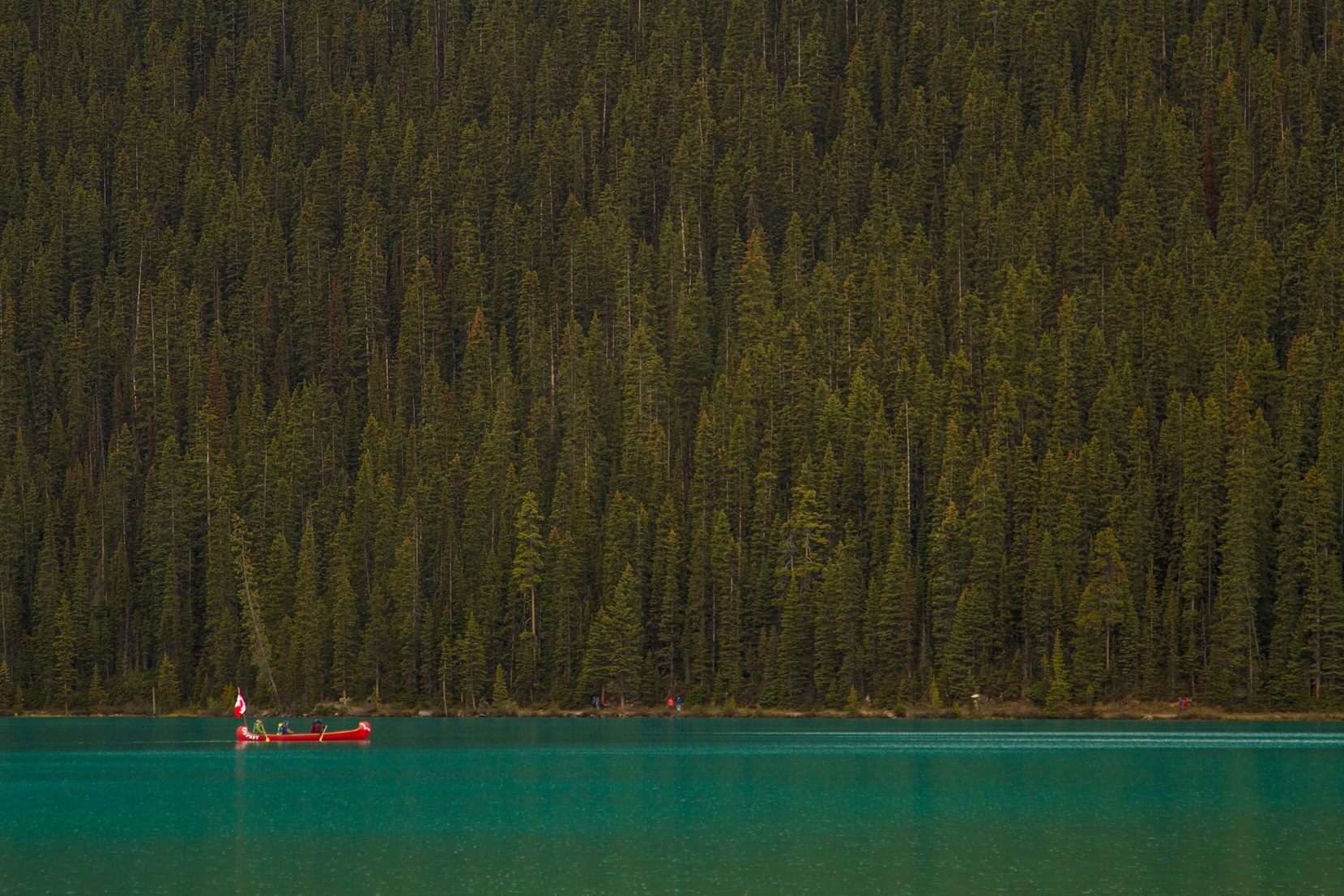 Canoeing on Lake Louise is a unique way to enjoy both the lake and the rugged peaks of Banff National Park.