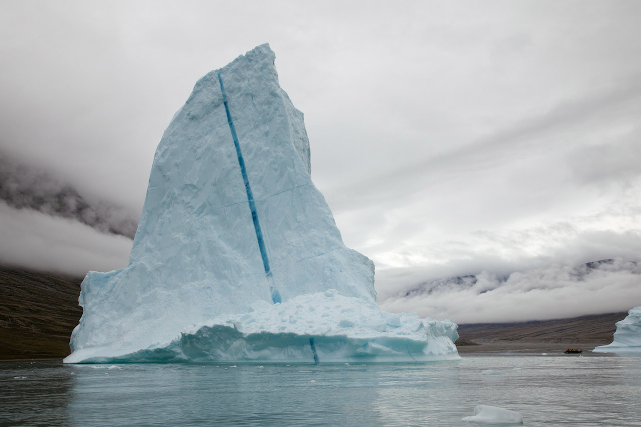 An iceberg drifts along in Scoresby Sound. Photo courtesy Aaron C.