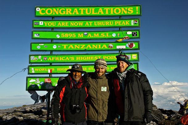 "At the top of Kilimanjaro with my mates"""