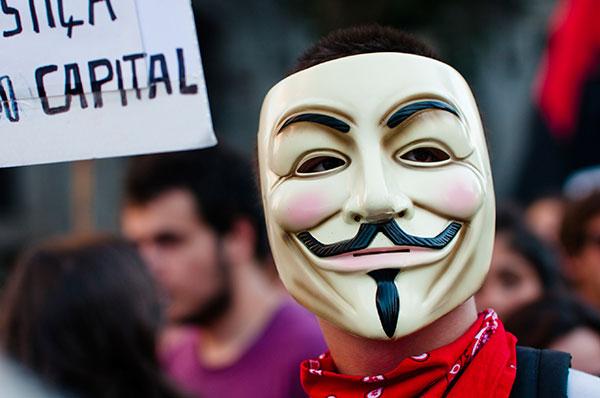 Demonstrator dons Guy Fawkes mask in Oporto, Portugal (September 15, 2012).