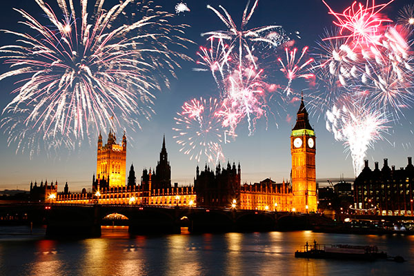 Fireworks over the Palace of Westminster as seen from the South Bank.