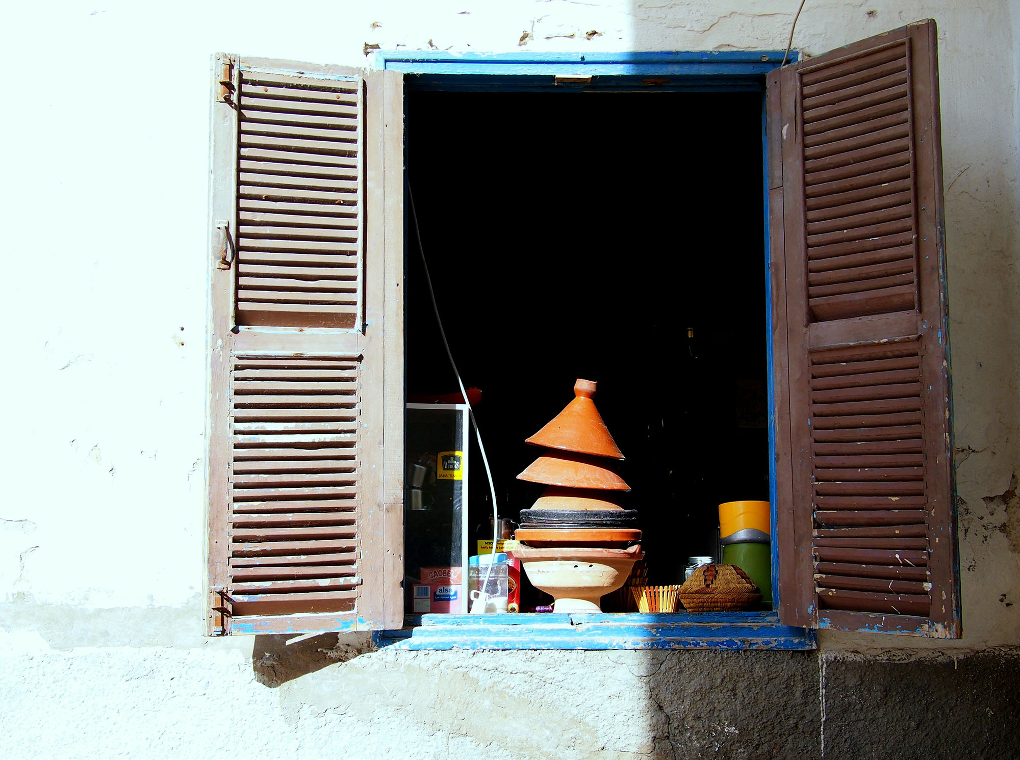 Clay tagines in a windowsill during a visit to Essaouira, Morocco.