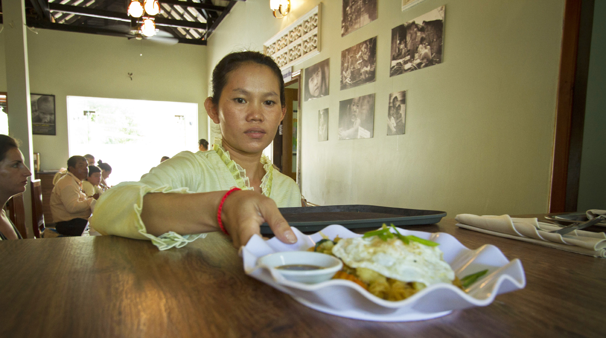 Enjoy a traditional meal of Khmer food at the New Hope Vocational Training Restaurant.