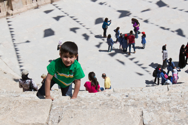 Child climbing the steps at Jerash