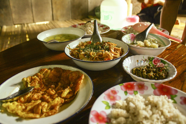 Pitch in and help make a meal with the Hilltribe's in Thailand.