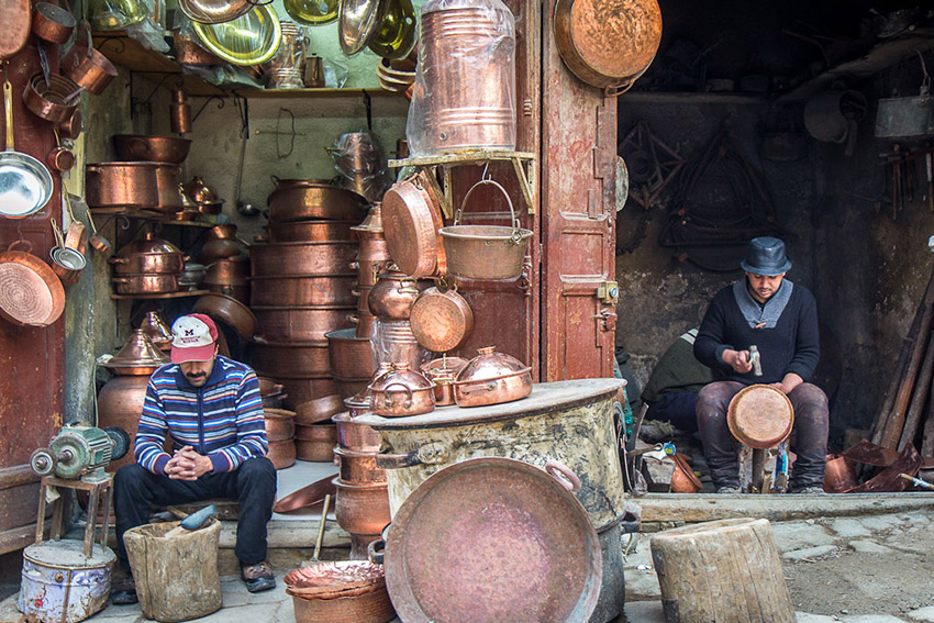 A cooper pot gets hammered into shape in the Fez Medina.
