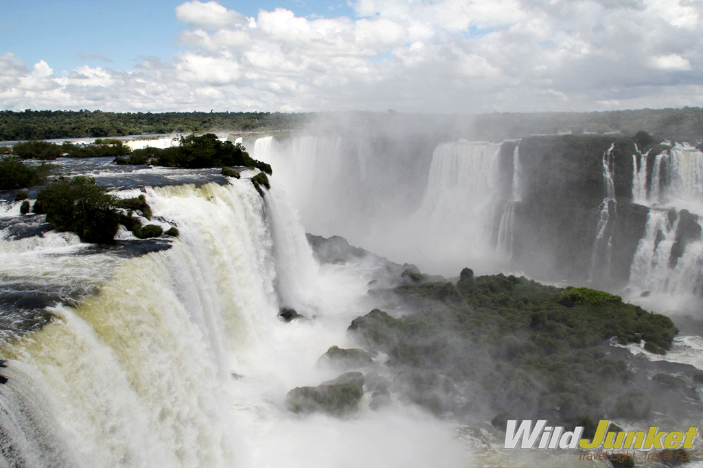 Watch the water from the Iguazu River flow over the Paraná Plateau.