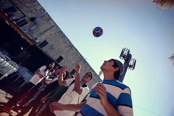 Kids playing ball in Akko Israel.