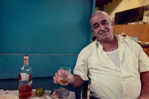 Local man enjoying a drink in Akko Israel.