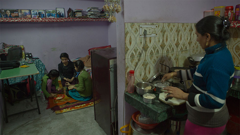 Shanti at home with her three daughters.