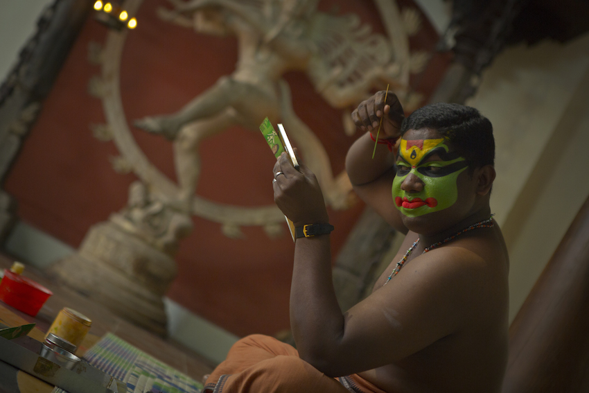 A Khatakali dancer prepares for the performance.