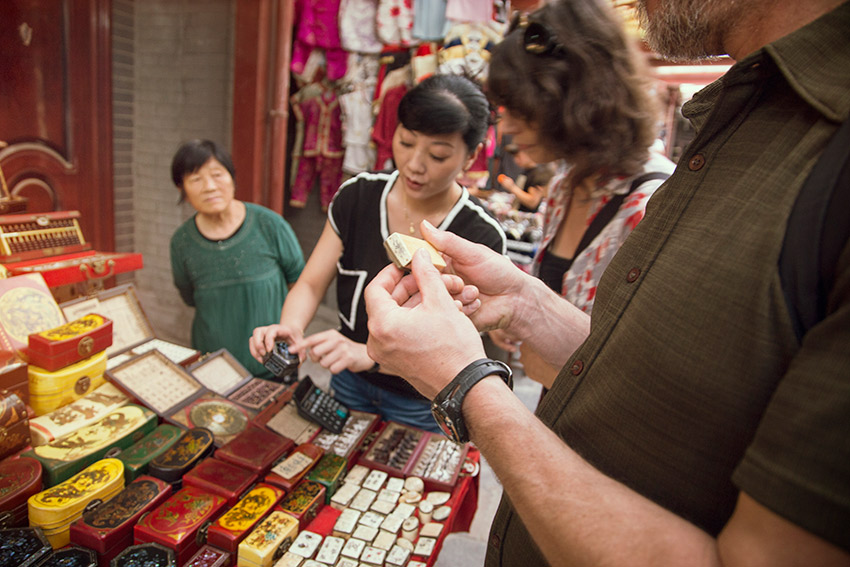 Treat haggling at the market as a game.