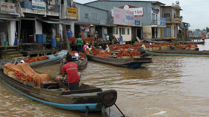 Merchants on the Mekong River. Photo courtesy JvL.