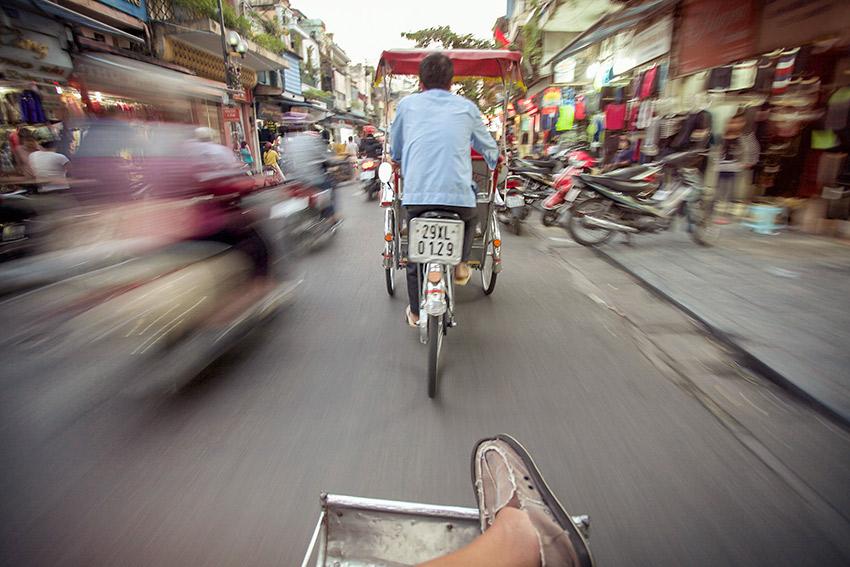 Speeding through the streets in Hanoi.