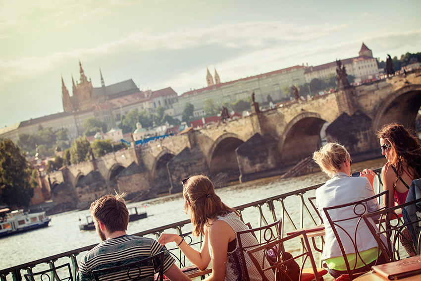 Take in the sights over a local brew in Prague.