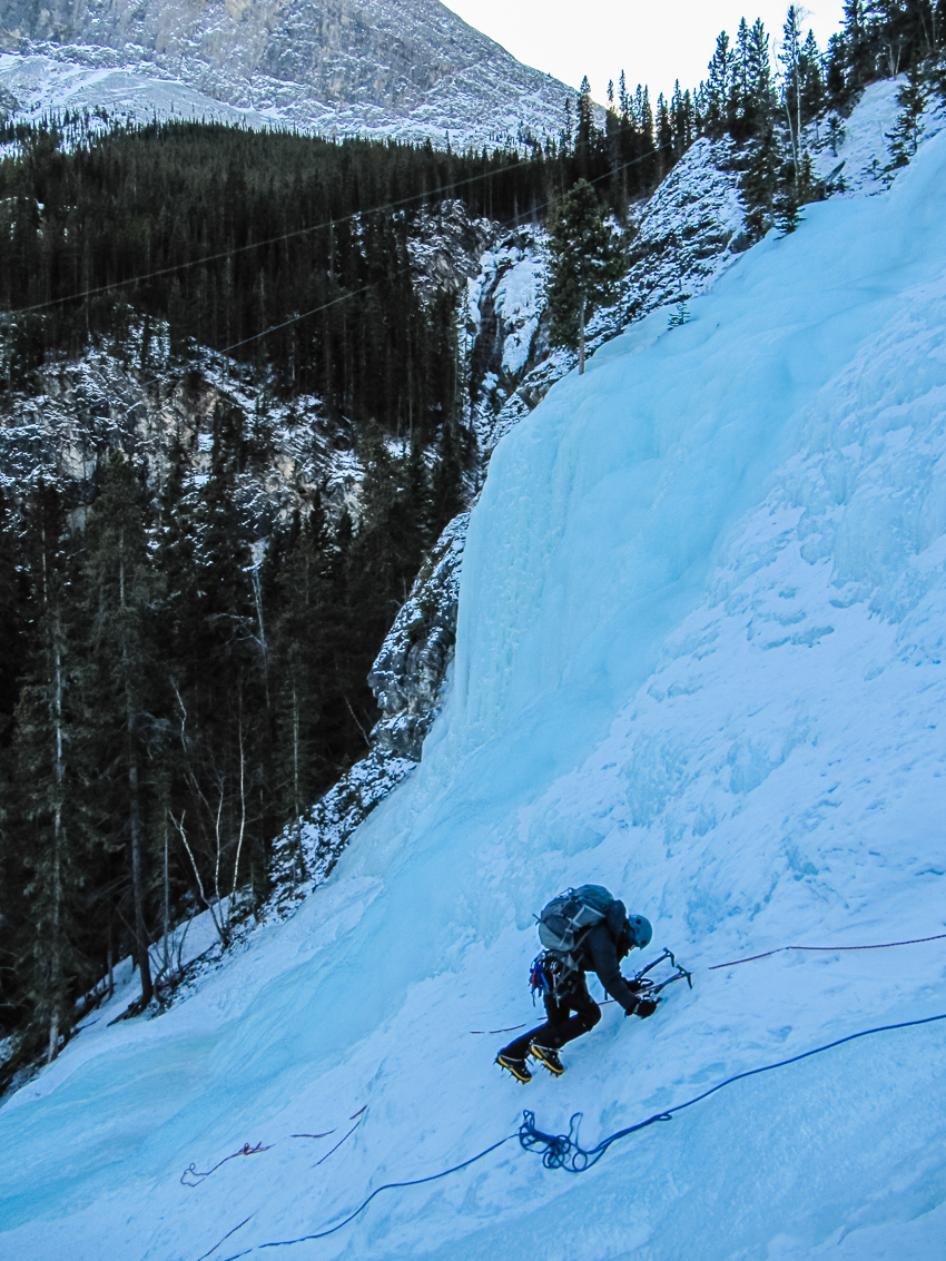 man ice climbing in the mountains.