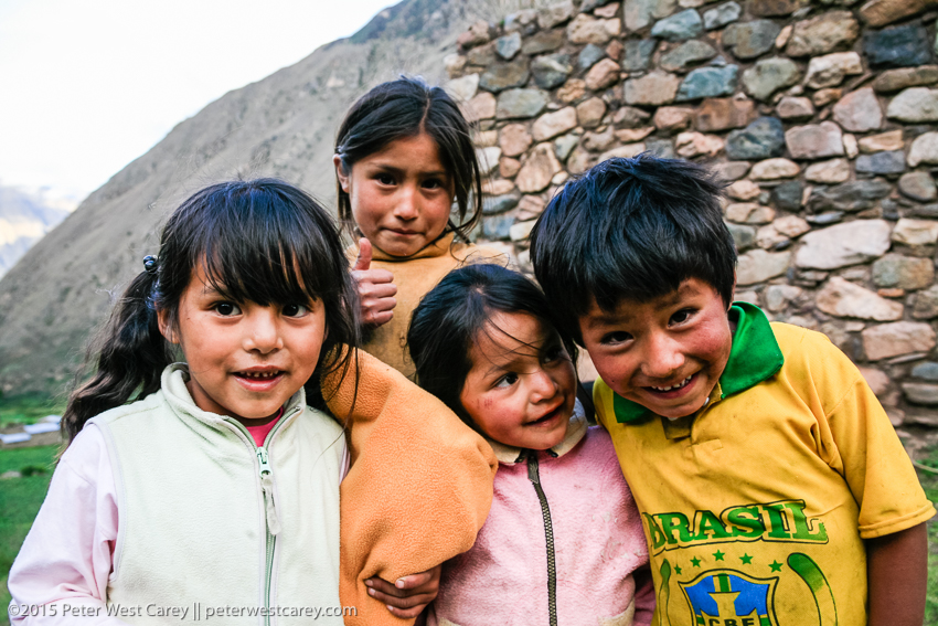 three kids playing and laughing in peru.