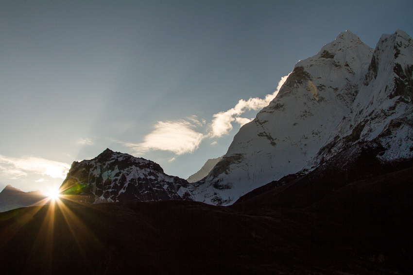 These warming rays from the sun as it inches over the shoulder of Ama Dablam were worth the wait.