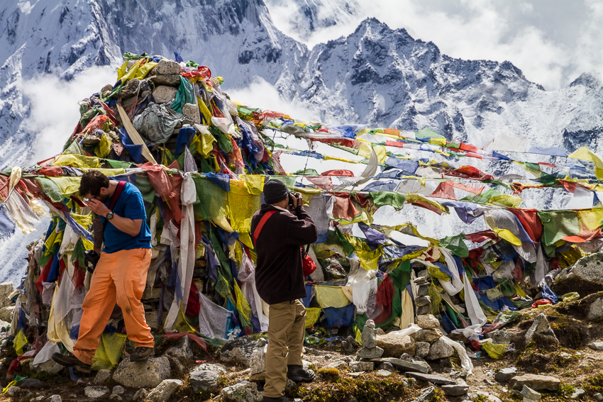 Colourful prayer flags surround the chortens.