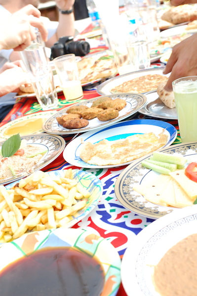 a table full of plates and food