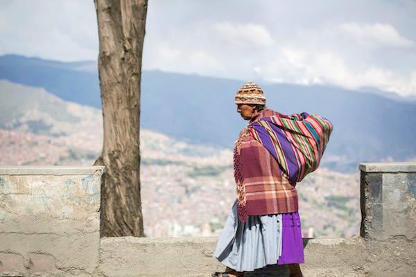 A woman walks high above the streets of La Paz, Bolivia.
