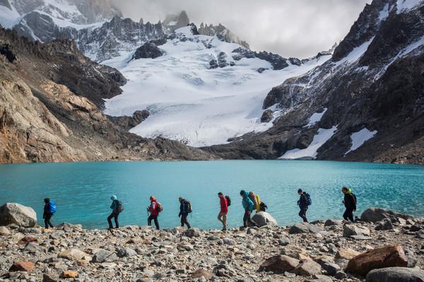 Hikers pass an emerald lagoon near Argentina's Mt Fitz Roy.