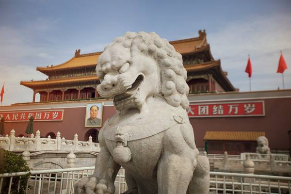 A stone lion guards the entrance to the Forbidden City in Beijing, China.