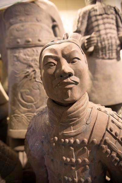 A terracotta warrior guards the tomb of Emperor Qin Shi Huang in Xi'an, China.