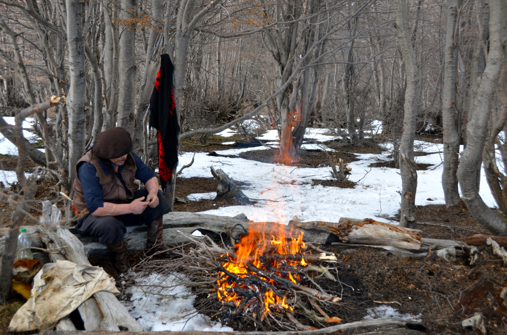 Lucho preparing a fire for us to warm our bones. Photo courtesy Keith Hajovksy.