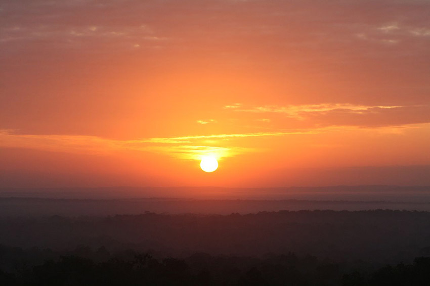 You won't soon forget watching the sun rise at Tikal. Photo courtesy Carsten B.