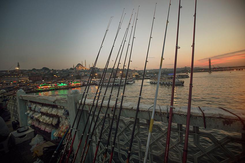 Sunset falls on the Galata Bridge in Istanbul.
